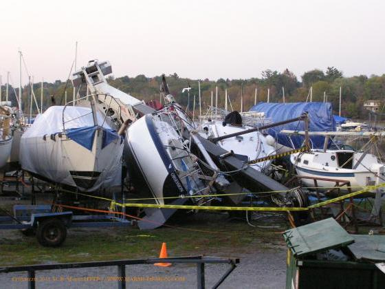 Crane lying on top of damaged yachts